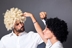 Man and Woman with Wig. Young Man and Woman with Colorful Funny Wig Stock Photo