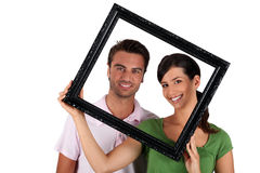 Man and woman withframe Royalty Free Stock Photo
