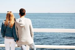 Man and Woman Beside Wooden Hand Rail Beside Body of Water Royalty Free Stock Photos