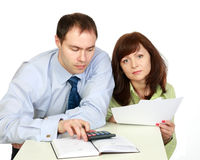 A man and woman work. stock images