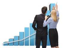 Man and woman working with 3d graphics Royalty Free Stock Photography
