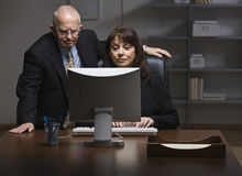 Man and Woman Working on Computer Stock Photos