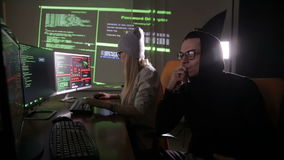 Man and woman working with computer, hacking computer system. stock footage