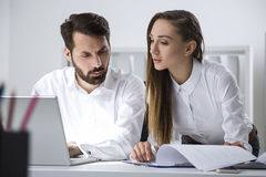 Man and woman working with documents Royalty Free Stock Photo