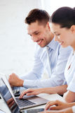 Man and woman working with laptop in office Stock Photo