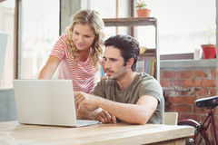 Man and woman working on laptop in office Royalty Free Stock Images