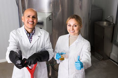 Man and woman working on modern brewery Stock Image