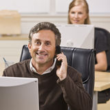 Man and Woman Working in Office Stock Image