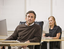 Man and Woman Working in Office Royalty Free Stock Image
