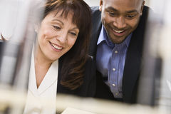 Man and Woman Working in Office Royalty Free Stock Photo