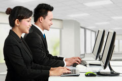 Man and woman working in the office Stock Image
