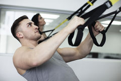 Man and woman working out with trx bands Royalty Free Stock Photos