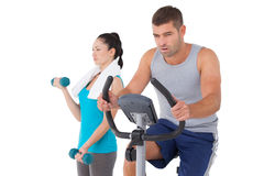 Man and woman working out Stock Images
