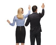 Man and woman working with something imaginary Royalty Free Stock Photography