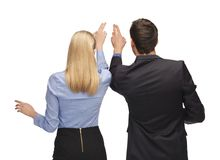Man and woman working with something imaginary Stock Photo