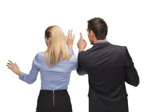 Man and woman working with something imaginary Royalty Free Stock Image