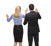 Man and woman working with something imaginary Royalty Free Stock Photo