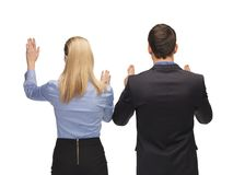 Man and woman working with something imaginary Stock Photography