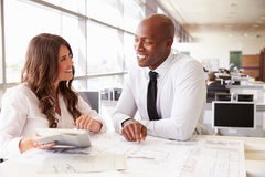 Man and woman working together in an architect?s office. Man and women working together in an architect?s office royalty free stock image