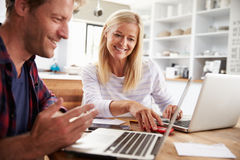 Man and woman working together at home Stock Photography