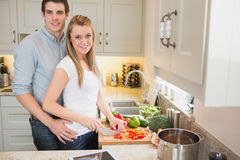 Man and woman working together in the kitchen Royalty Free Stock Photo