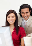 Man and woman working together smiling Stock Photos