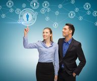 Man and woman working with virtual screen Stock Photos