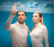 Man and woman working with virtual screen Royalty Free Stock Photo