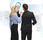 Man and woman working with virtual screen Stock Photo
