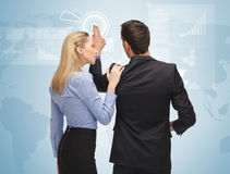 Man and woman working with virtual screen Royalty Free Stock Photography