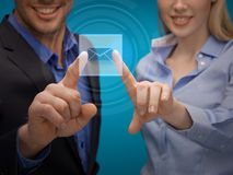 Man and woman working with virtual screen Stock Images