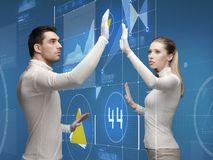 Man and woman working with virtual screen Royalty Free Stock Image