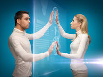 Man and woman working with virtual screens. Picture of men and women working with virtual screens Royalty Free Stock Photography