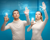 Man and woman working with virtual screens. Picture of men and women working with virtual screens Stock Image