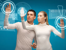 Man and woman working with virtual screens. Picture of men and women working with virtual screens Stock Photos