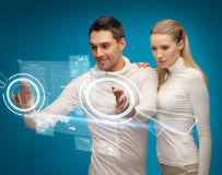 Man and woman working with virtual screens. Picture of men and women working with virtual screens Royalty Free Stock Photos