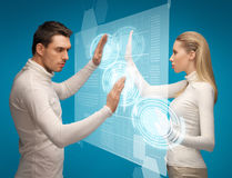 Man and woman working with virtual screens. Picture of men and women working with virtual screens Royalty Free Stock Photo
