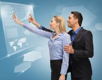 Man and woman working with virtual touch screens. Picture of men and women working with virtual touch screens Stock Photo