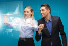 Man and woman working with virtual touch screens. Picture of men and women working with virtual touch screens Royalty Free Stock Photo