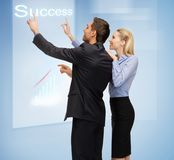 Man and woman working with virtual touch screens Royalty Free Stock Photo