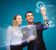 Man and woman working with virtual touch screens. Picture of men and women working with virtual touch screens Stock Photography