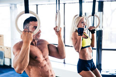 Man and woman workout on fitness rings Stock Images