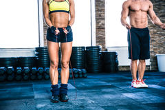 Man and woman workout with jumping rope. Man and women workout with jumping rope at crossfit gym Royalty Free Stock Photos