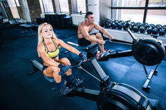 Man and woman workout on training simulator Stock Photography