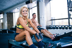 Man and woman workout on training simulator Royalty Free Stock Images