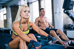 Man and woman workout on training simulator Royalty Free Stock Photo
