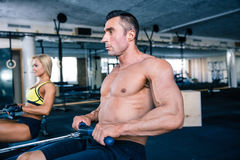 Man and woman workout on training simulator Royalty Free Stock Photography