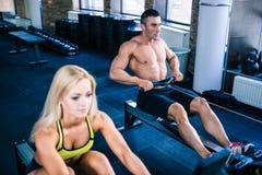 Man and woman workout on training simulator Stock Photo