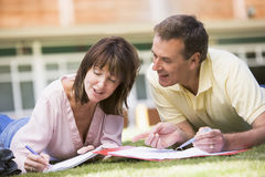 A man and woman writing notes stock photography