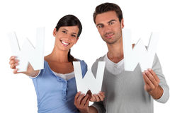 Man and woman with www initials Royalty Free Stock Photos